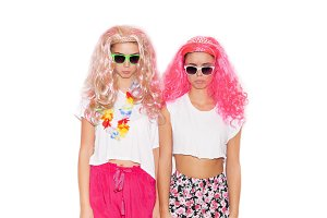 Girls in colorful wigs and clothing