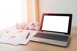 laptop and crumpled paper