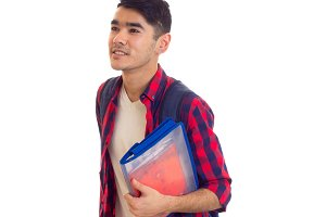 Young man with backpack and copy-books