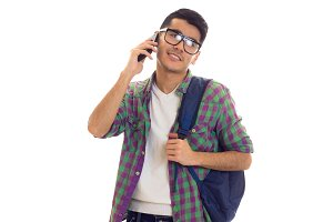 Young man with backpack and smartphone