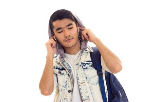 Young man with backpack and headphones