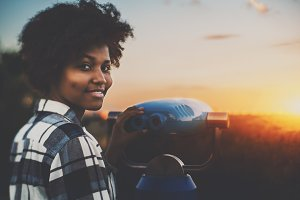 Black girl with street binocular