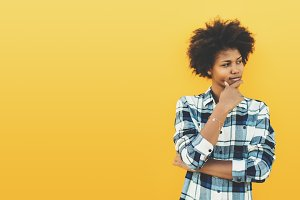 Black girl on yellow background