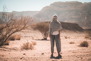 woman in sunglasses and a scarf in the desert