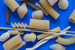 Traditional Italian pasta, blue background