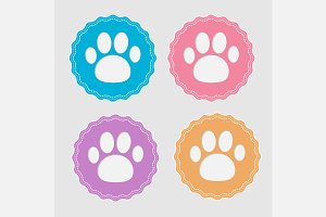 Set of four labels with paw print.