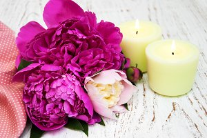 Peony flowers with candles