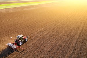 Aerial shot of a farmer sowing crops