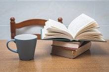 Some books and a cup on a table