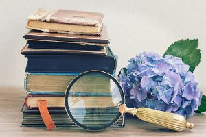 old books with  looking glass