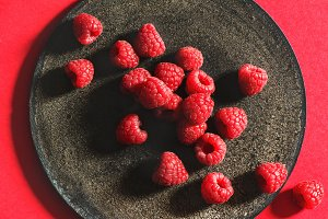 Fresh raspberries on rustic plate