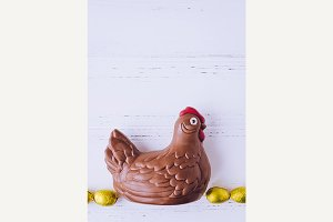 Easter composition with chocolate chicken and eggs