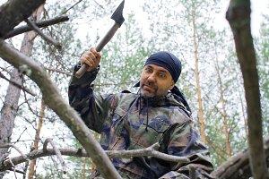 Brutal man chopping wood