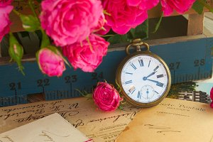 old letters  with flowers and clock