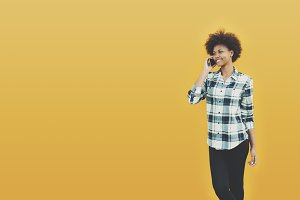Black teen girl with smartphone