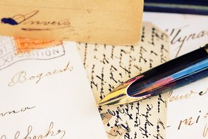 golden quill pen and antique letters