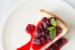 Tasty cheesecake with fruit sauce