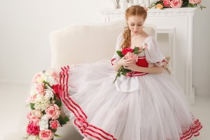 Lovely ballerina holding flowers