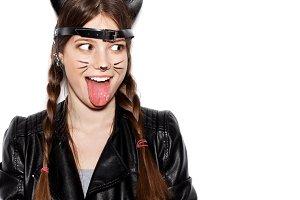 Funny girl represents as small cat having fun
