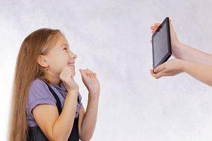 The girl enjoys the new tablet