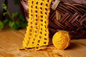 Yellow knitting with crochet