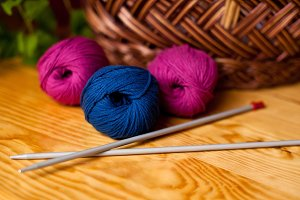 Magenta and blue skeins with needles