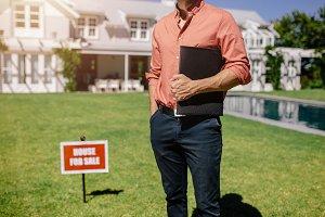 Male real estate broker