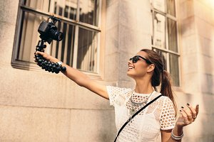 Young tourist recording selfie video