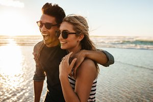 Beautiful young couple on beach