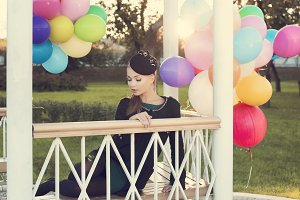 woman with colorful latex balloons