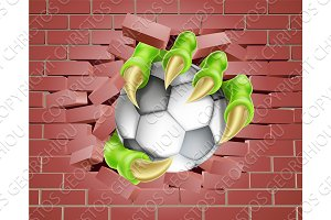 Claw with Soccer Ball Breaking Through Brick Wall