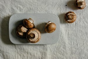 raw mushrooms in blue Stone table