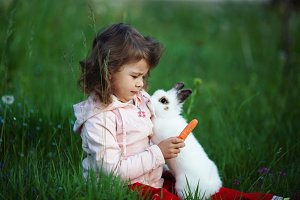 cute little girl with white rabbit