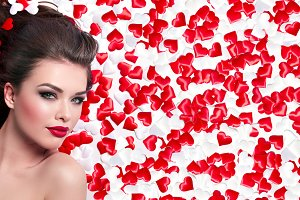 Girl lies in small red hearts #1