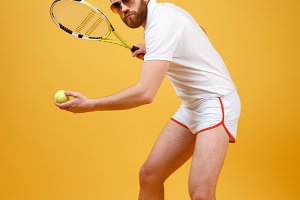 Attractive young tennis player wearing glasses