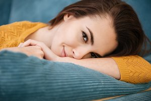 Portrait of a lovely young girl lying on a pillow