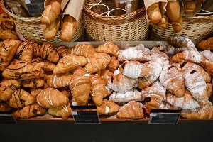 Sweet croissants in supermarket bakery