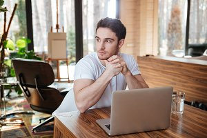 man with laptop looking away