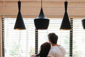 lovers against window