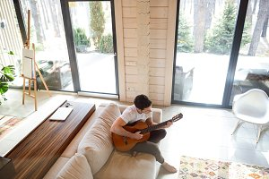topview of playing guitar on couch