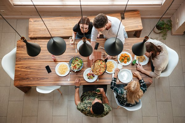 Top view of people having dinner to…