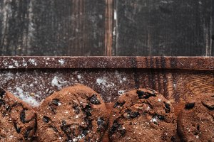 Cookies on desk on dark wooden table