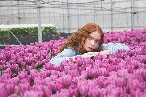 Girl lying on tulips