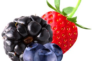 Isolated strawberry and blueberries