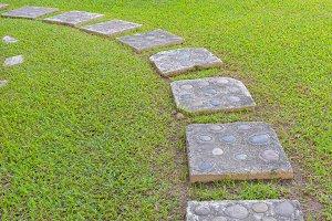pathway with green grass in garden