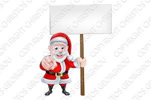 Santa Pointing at You with Sign