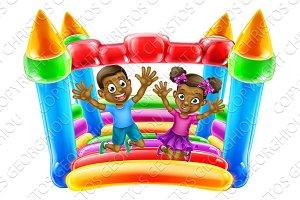Children Jumping on Bouncy Castle