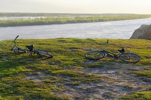 Two bicycles lying on a steep bank