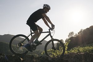 Man cycling cross- country