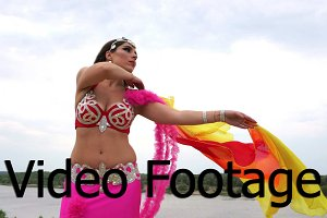 Girl dancing belly dance with shawl